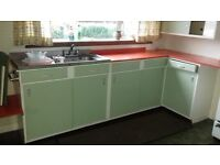 Retro 1960's kitchen units, green with orange Formica worktops.