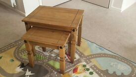 Rustic looking nest of two small tables in antique pine finish