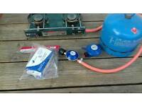 Camping cooker and gas bottle