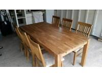 Solid oak dining table & six chairs