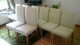 Cream faux leather seats 8 in total