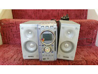Small used condition cd radio Hitachi model 5 pounds Not used for a while