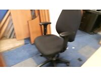 Black executive office chairs with adjustable armrests