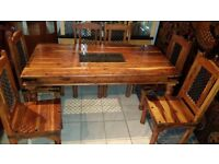 beautiful solid wood dining table and 6 chairs excellent condition