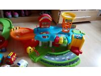 Vtech toot toot garage, police station and 5 vehicles