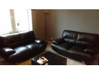 2 black leather sofas . £150 each or £250 for both