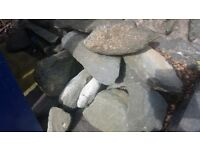 18Sq Metres of Grey slate for crazy paving. Assortment of rockery rocks and over 200 building bricks