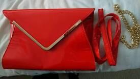 Large red/orange clutch bag