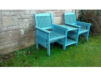 Wooden slatted double bench with central little table, painted blue