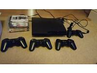 PS3 slim 160 GB with 4 Controllers and 5 Games