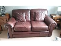 Chocolate leather sofa and matching armchair