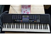 Yamaha Electric Keyboard, with manual & power unit. Perfect condition.