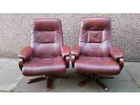 Pair of vintage retro leather swivel chairs
