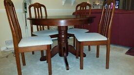 Beautiful dark table and chairs with cream seats for sale