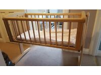 Mothercare swinging crib in natural wood finish