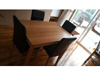 Dining table and 4 black leather imitation chairs