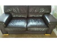 2 seater brown leather sofa perfect condition!