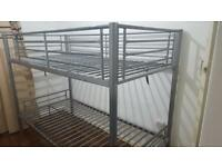 Single metal bunk bed with two mattresses