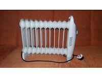 Heater. Challenge 1kW Mini Oil Filled Radiator. New , not in box. Argos price £40. Powerfull .
