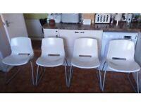 cream plastic dining chairs X 4
