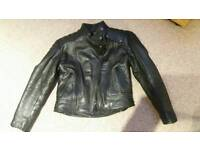 Ladies motorcycle gear, leather jacket, jeans and boots