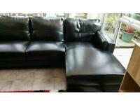 Designer black leather corner sofa