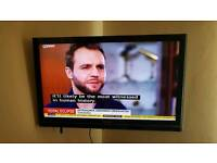 "Toshiba 40"" TV With freeview, remote, and stand."