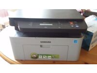 Samsung Laser printer (Xpress M2070), Black and white with new ink cartridge