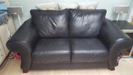 2 seater black leather sofa .