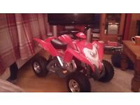 Childs battery operated quad bike