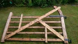 Large and small wooden 5 bar gates