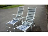 Two reclining garden chairs with foot rests £35 ono