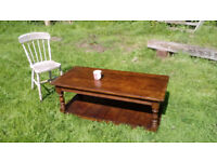 Large solid oak coffee table: French dark oak with turned legs and bottom shelf.