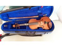 1/2 size Stentor violin and bow in case, good condition