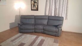 Ex-display Ralph light grey leather and fabric manual recliner curved sofa