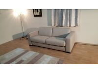 New Siesta oatmeal fabric 2,5 seater sofa bed