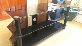 GLASS TV STAND WITH SHELVES.