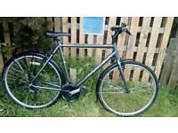 Here's a very nice ridgeback hybrid bike for sale
