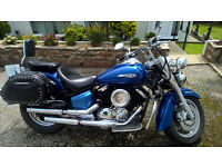 Yamaha XVS100 Dragstar Classic in Blue. Being on an H plate makes it 12 years young.