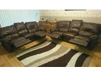 Two leather reclining three seater settee s