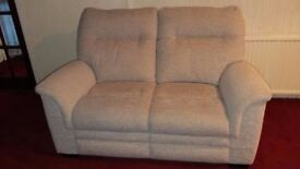 Two-seater sofa with matching electric riser recliner chair