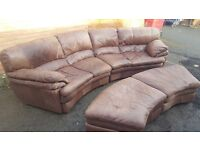Nice brown real leather curved sofa and 2 footstool,or use as a sofa bed, used, can deliver
