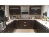 Kitchen wall cabinets with lift up doors and LED downlights