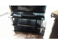 Immaculate black and chrome TV stand