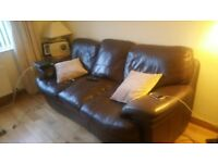 2 peice Leather suite . Three seater sofa and 1 seater armchair
