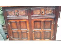 solid pine stained sideboard (carved designs on)