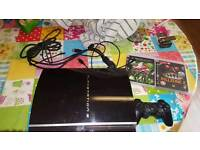 Playstation 3 with games and controller