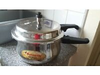 Butterfly curve Vol 5.5 lts stainless steel pressure cooker for sale