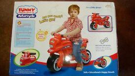 Kids ride a long motorbike