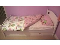 White wooden girls single bed with mattress